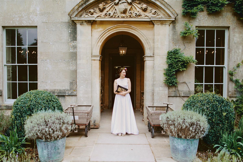 bride waiting in doorway or manor house in Somerset
