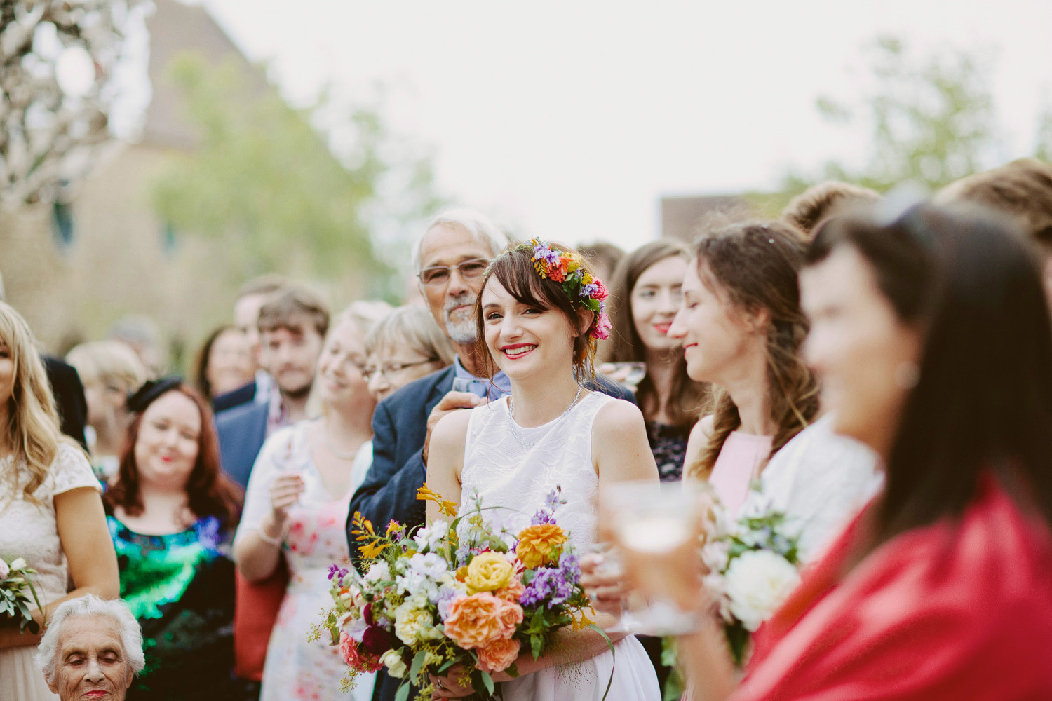 Bride laughing during speeches at Hauser & Wirth Somerset