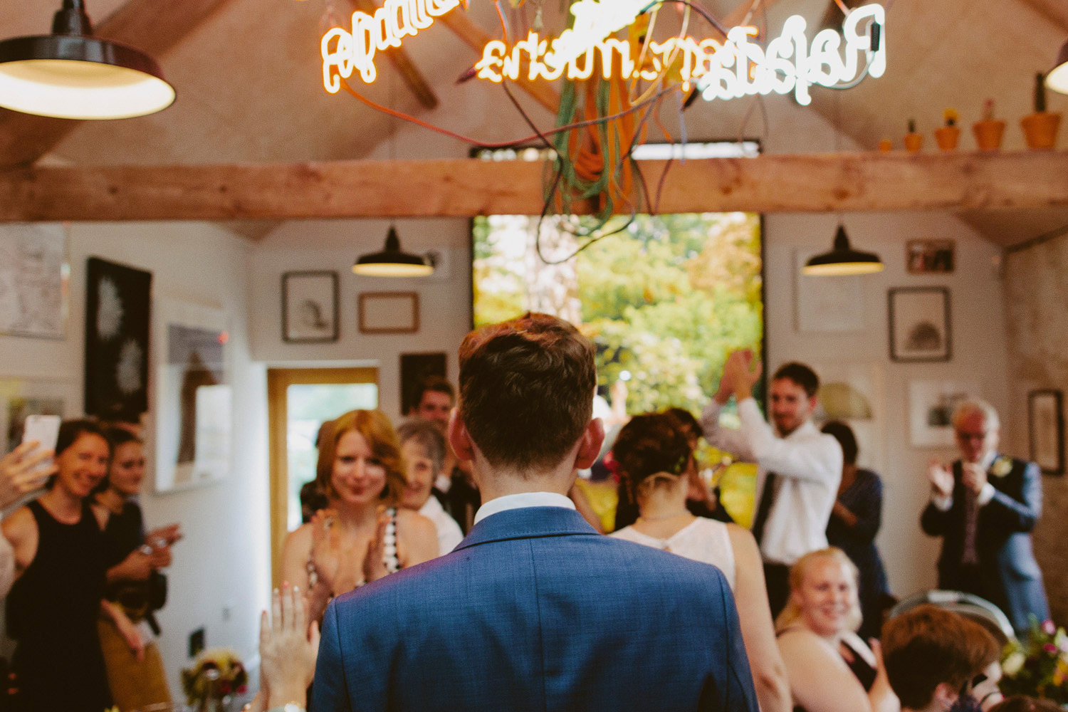 Bride and groom entering dining room at Hauser & Wirth Somerset wedding