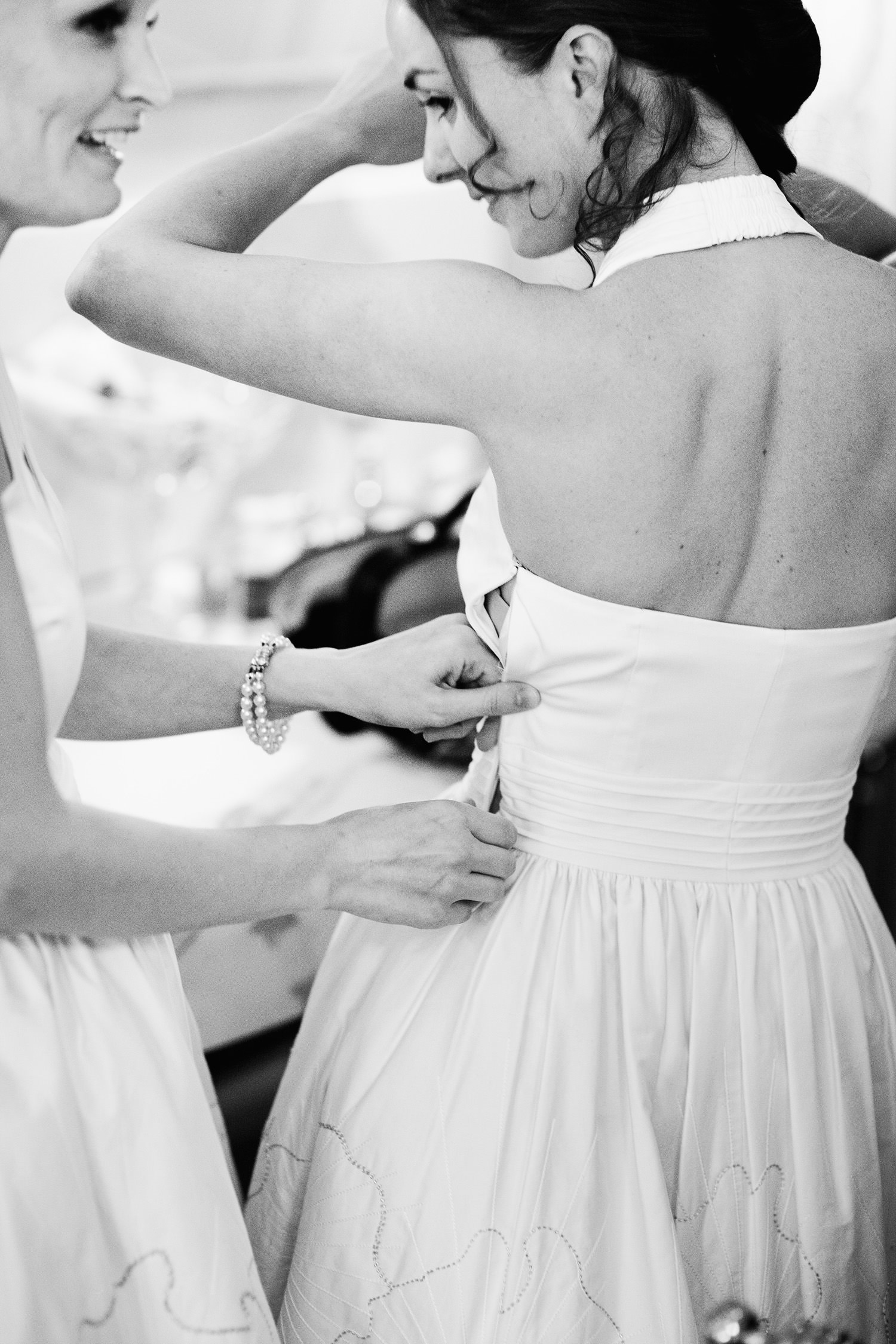 bridesmaids adjusting dresses