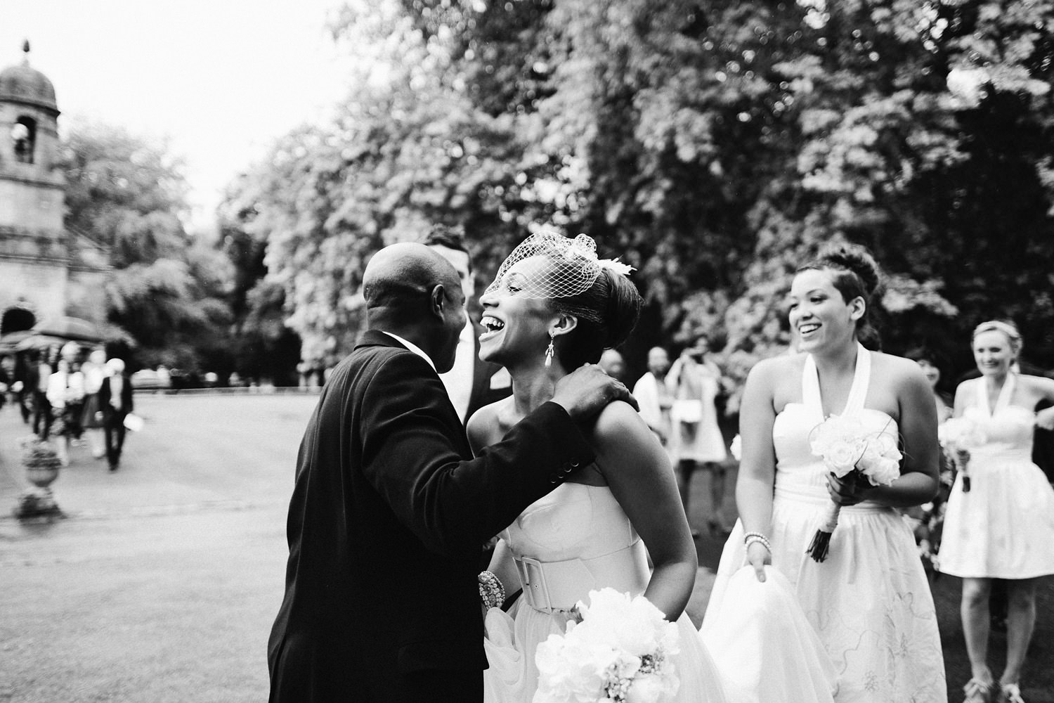 bride laughing outside church at Somerset wedding