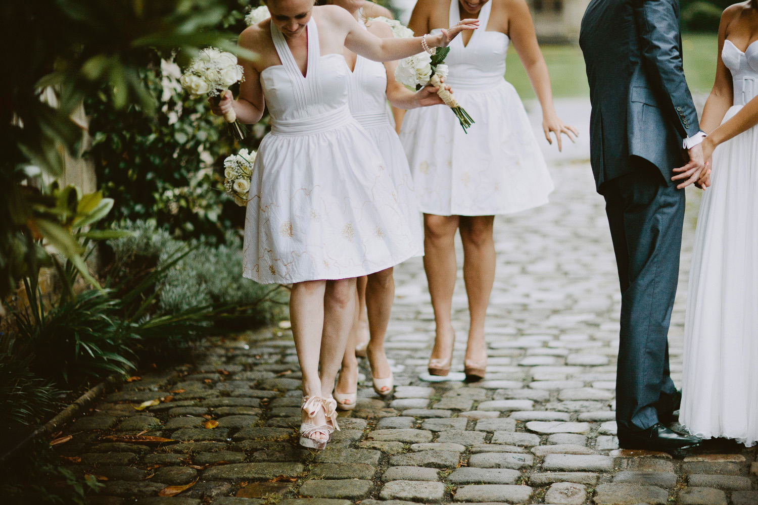 bridesmaids walking on cobbles