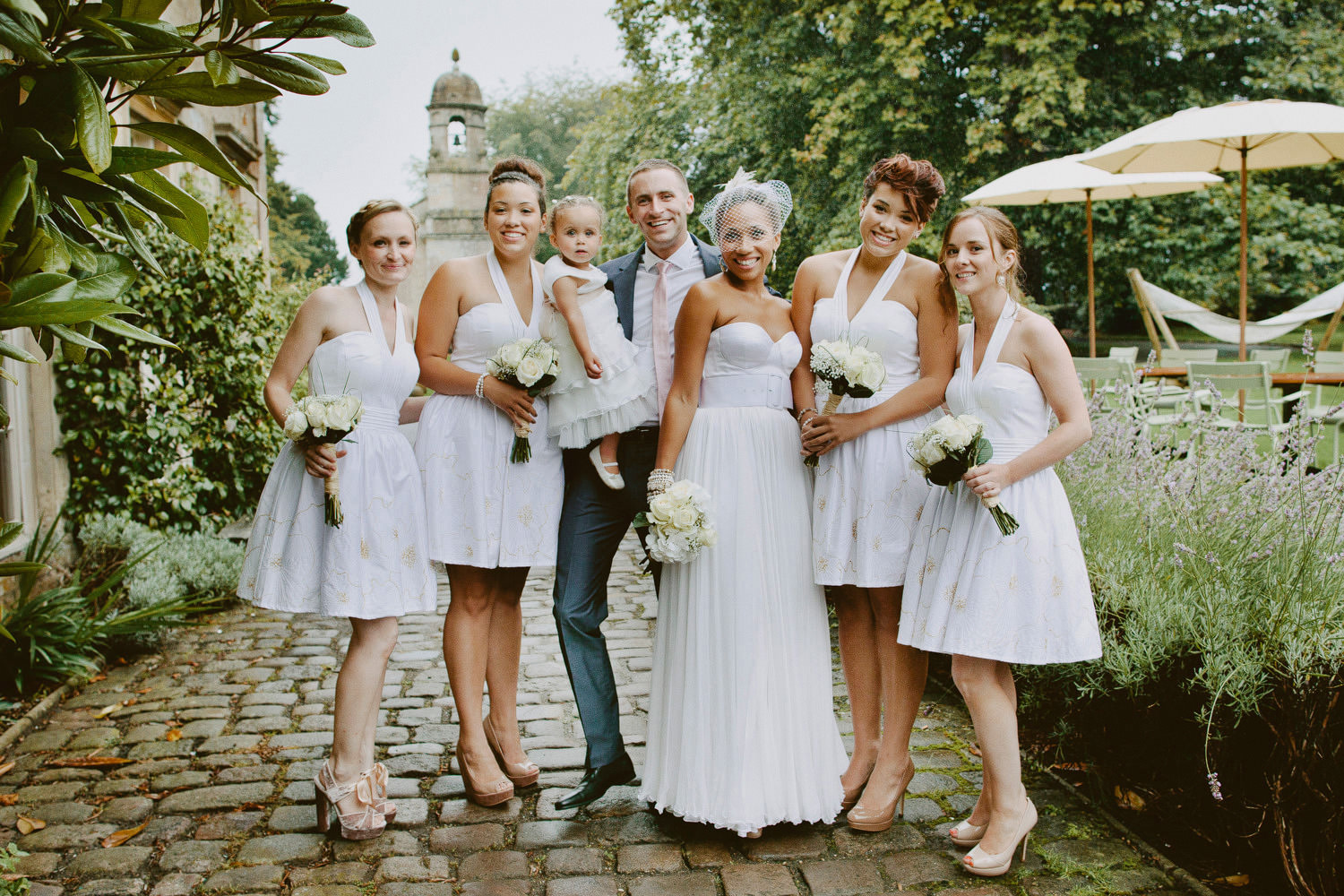 bridesmaids and bride and groom portrait outside Babington house Somerset