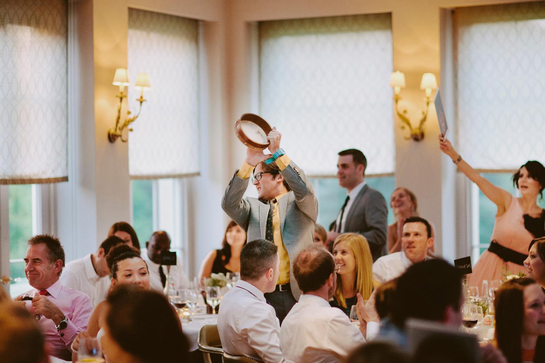 man playing tambourine at wedding in Somerset