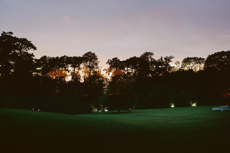 sun setting over somerset fields
