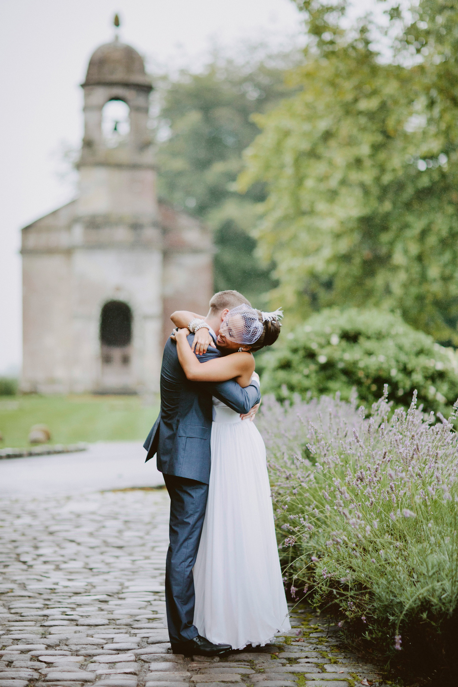 bride and groom hugging at wedding venue in Somerset