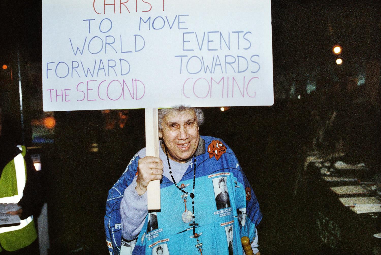 nun holding placard