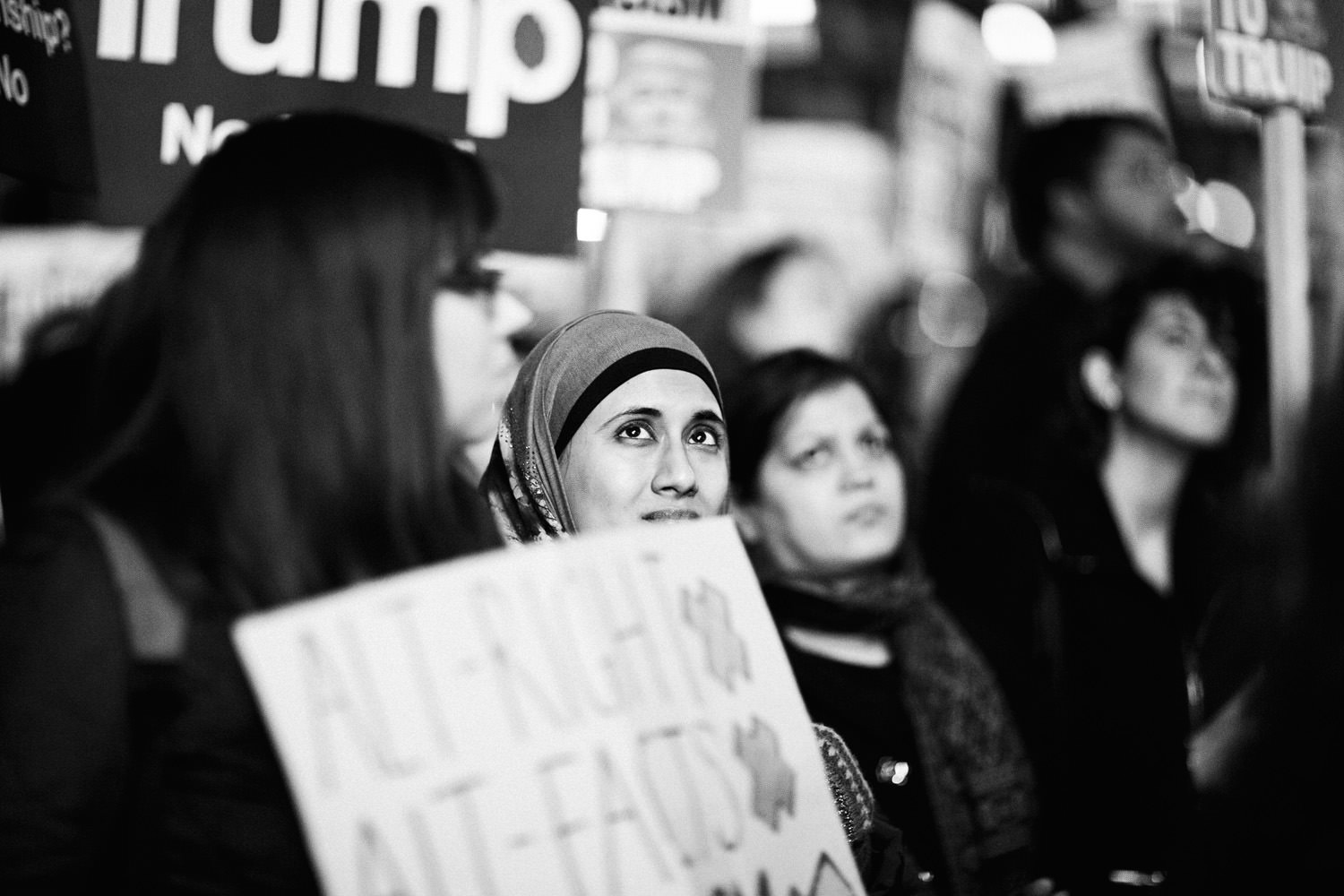 Muslim woman looking up at the march against Trump in London