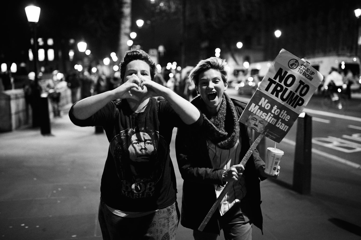 two young people laughing at March against Trumps state visit in London
