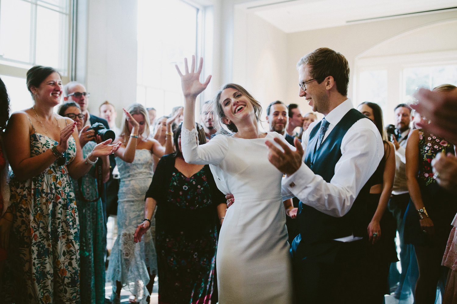 Bride and groom dance with guests during a Wilderness Reserve wedding