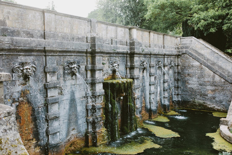 Italian fountain and lake at Cowley Manor in Cheltenham