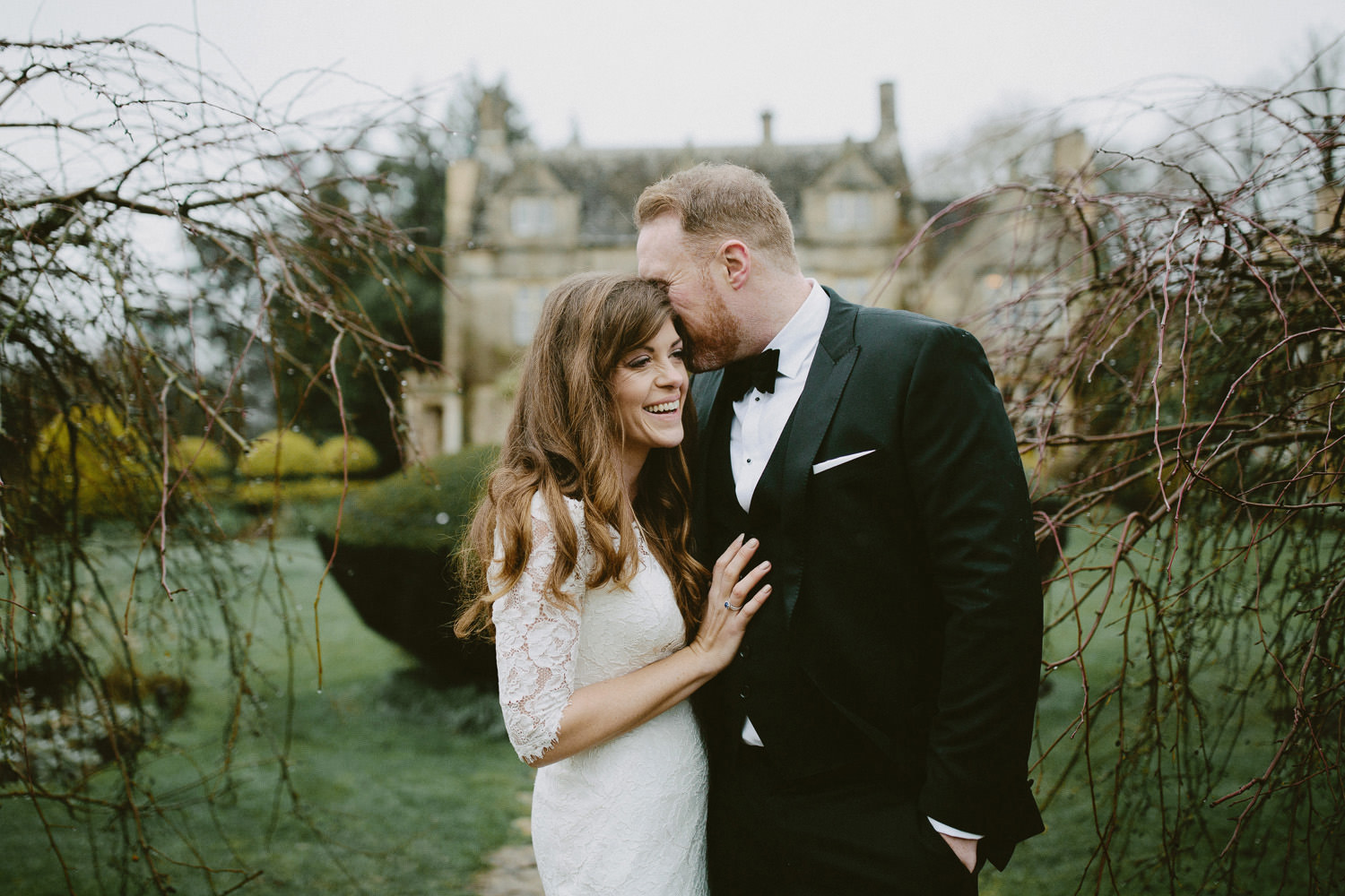 bride and groom in front of Barnsley House