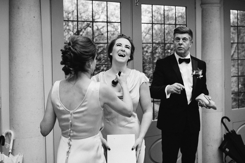 bridesmaid laughing at Barnsley house
