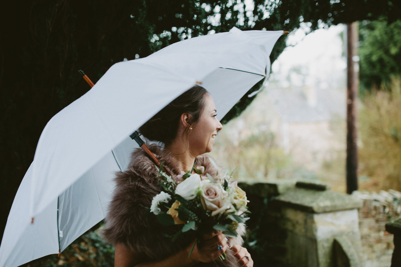 bridesmaid waiting with white umbrella