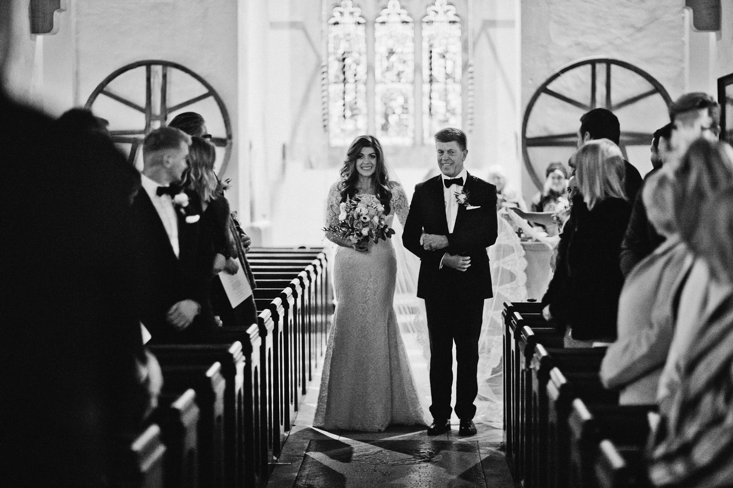 bride walking with father to front of church
