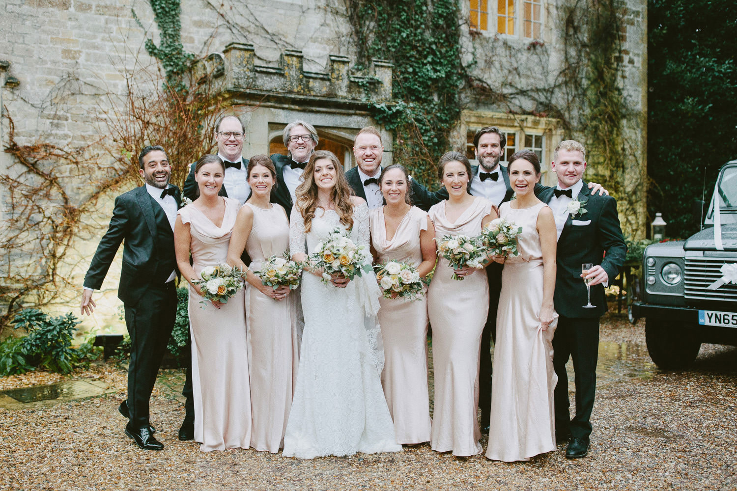 bridal party in front of Barnsley House