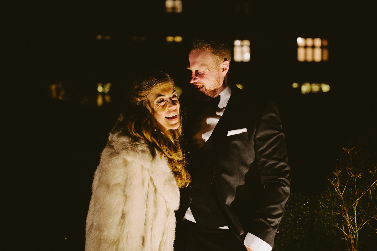 bride and groom outside Barnsley house at night time