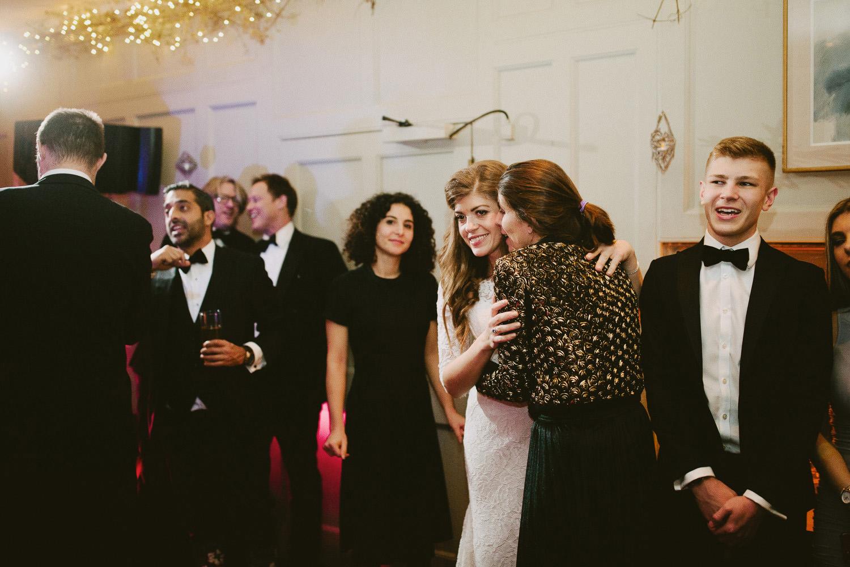 wedding guests laughing at Barnsley house