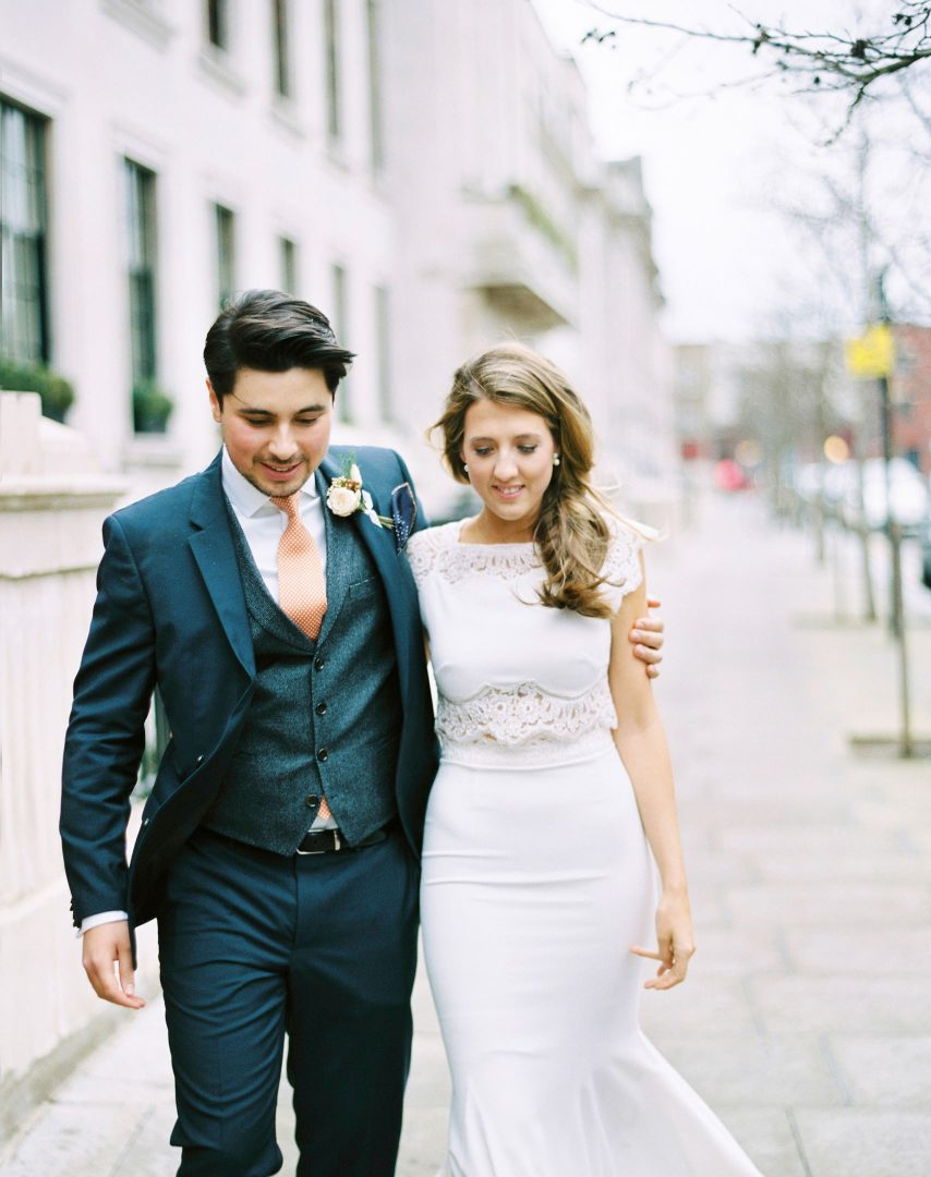 bride and groom walk down street