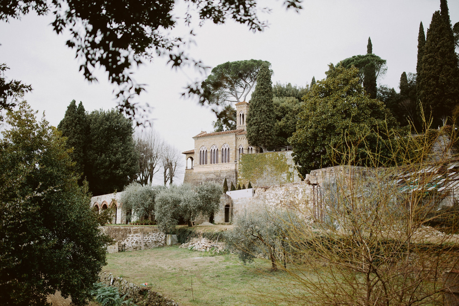 Villa Le Fontanelle surrounded by gardens and olive trees