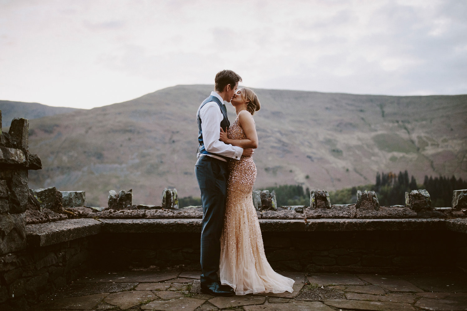 Bride and Groom kissing in front of Haweswater Hotel