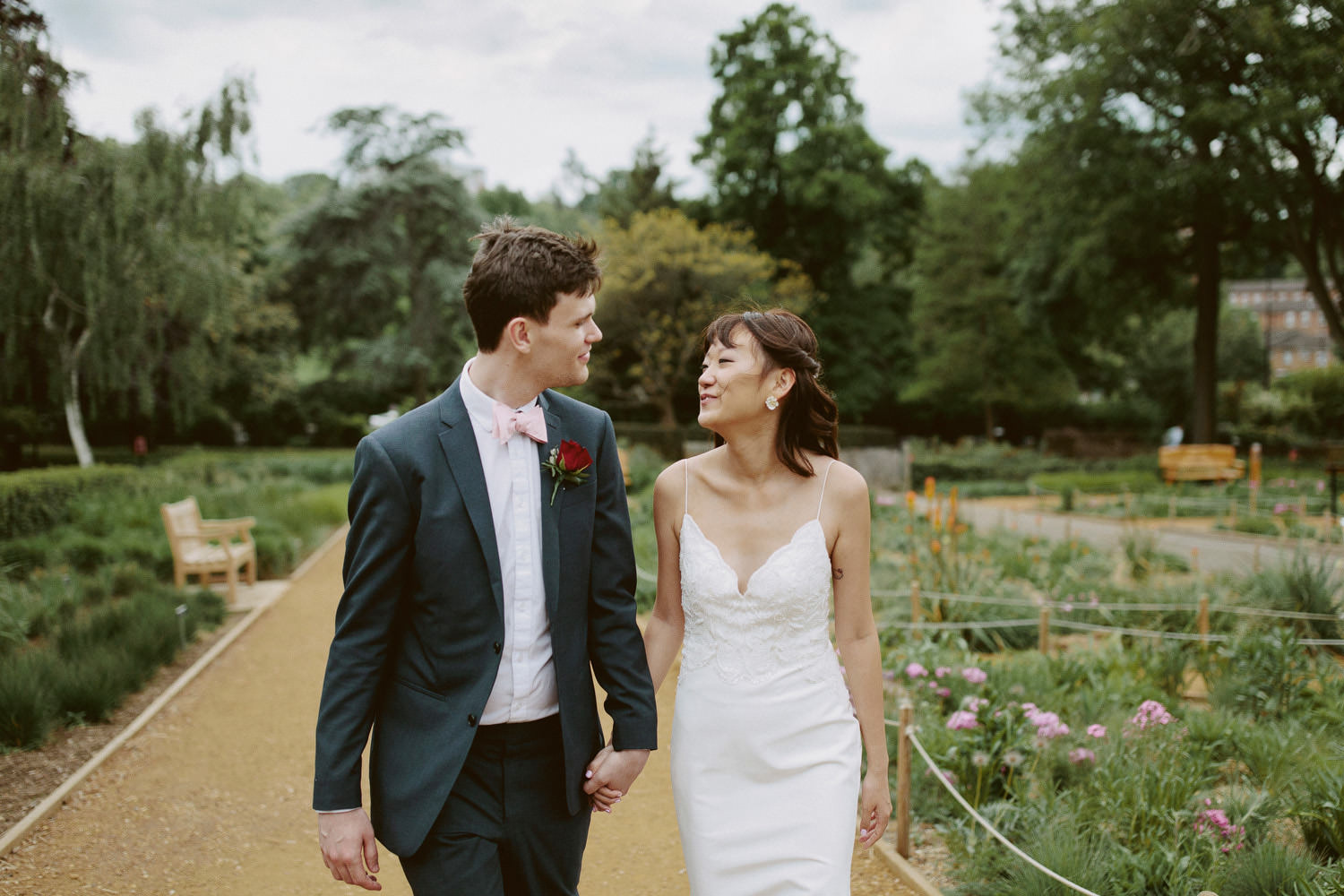 a bride and groom walking through the ground of Horniman Museum in South London
