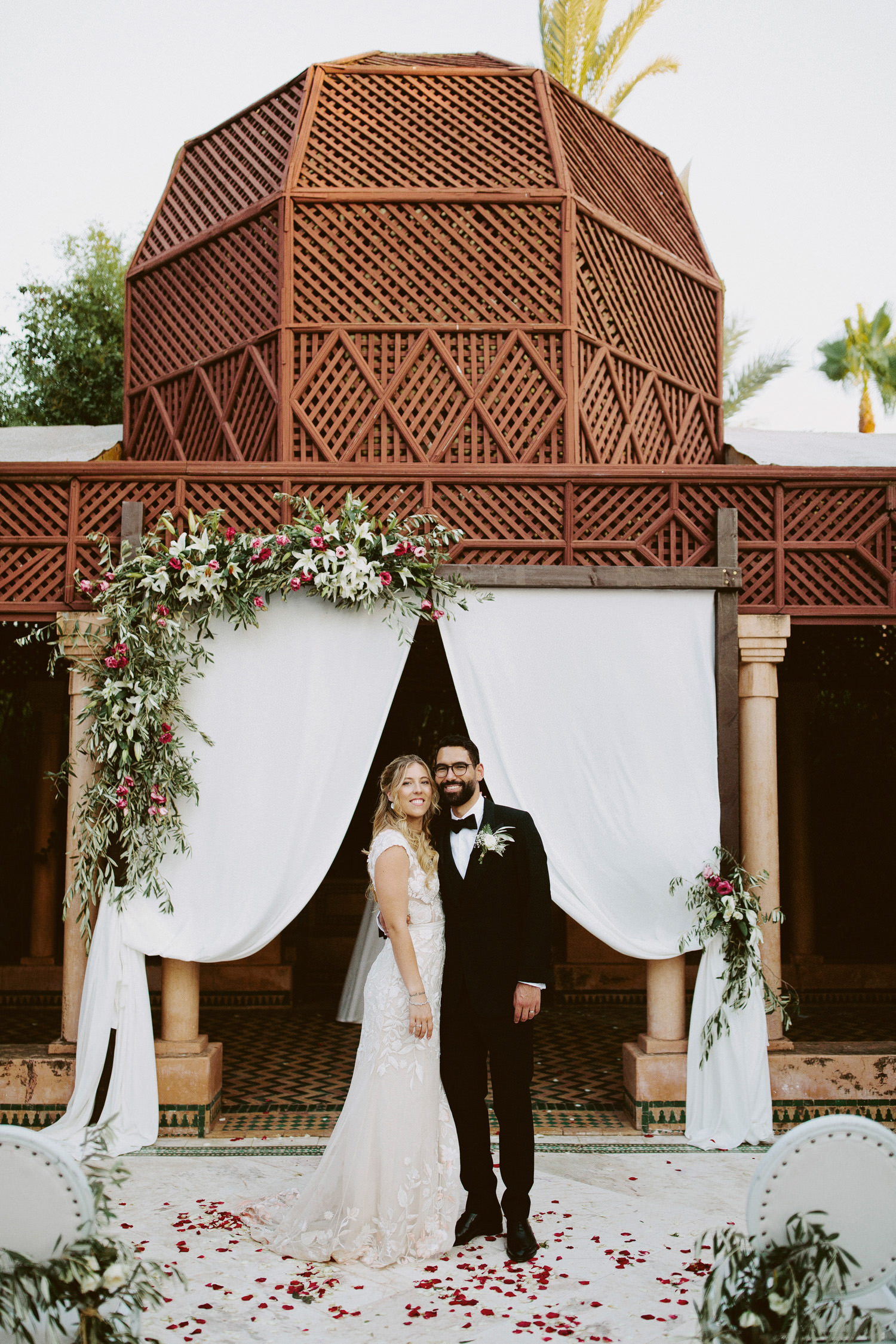 bride and groom stand in front of temple at Dar Ayniwen in Marrakech
