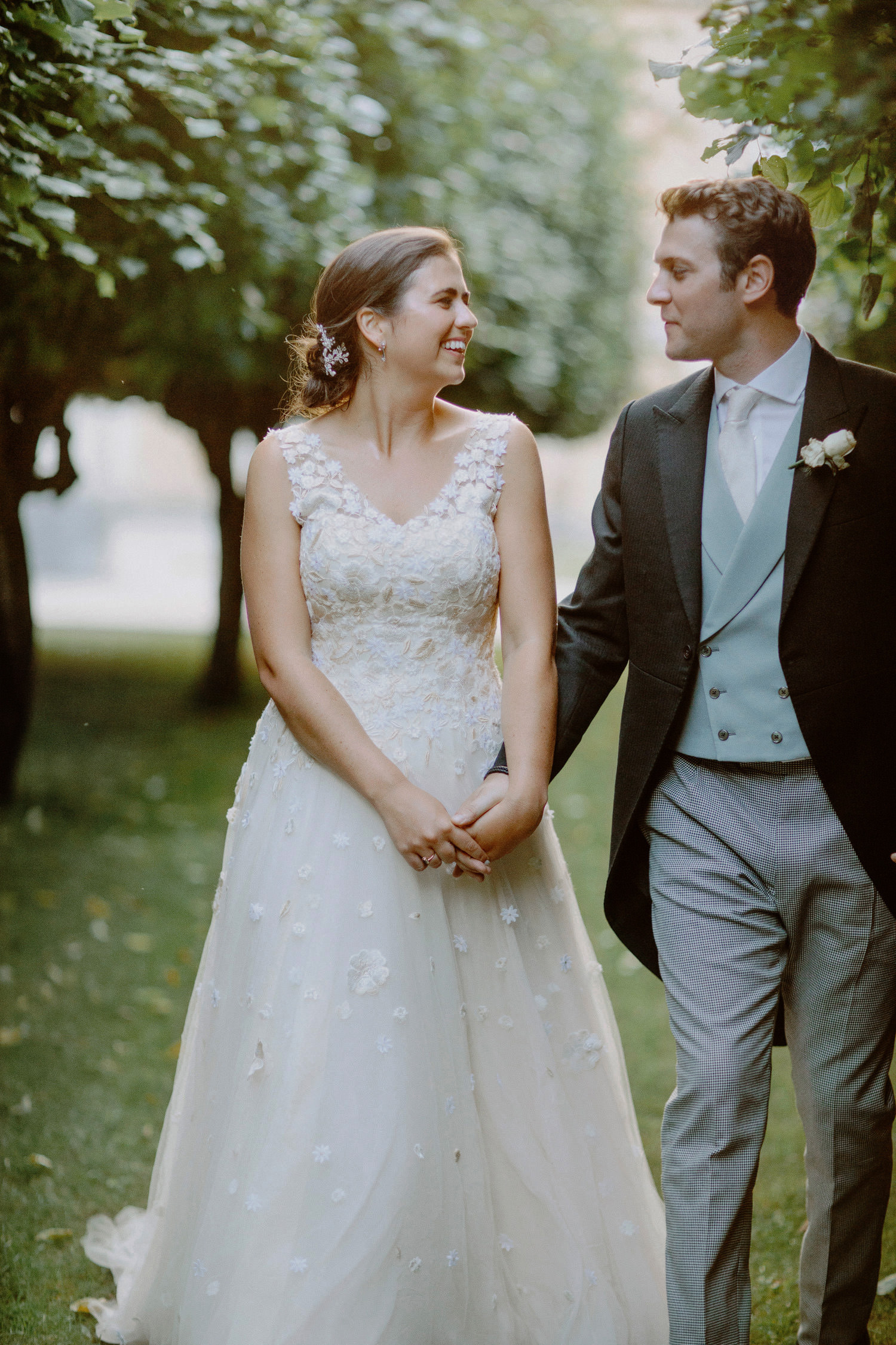 Bride groom look at each other at Chiswick House