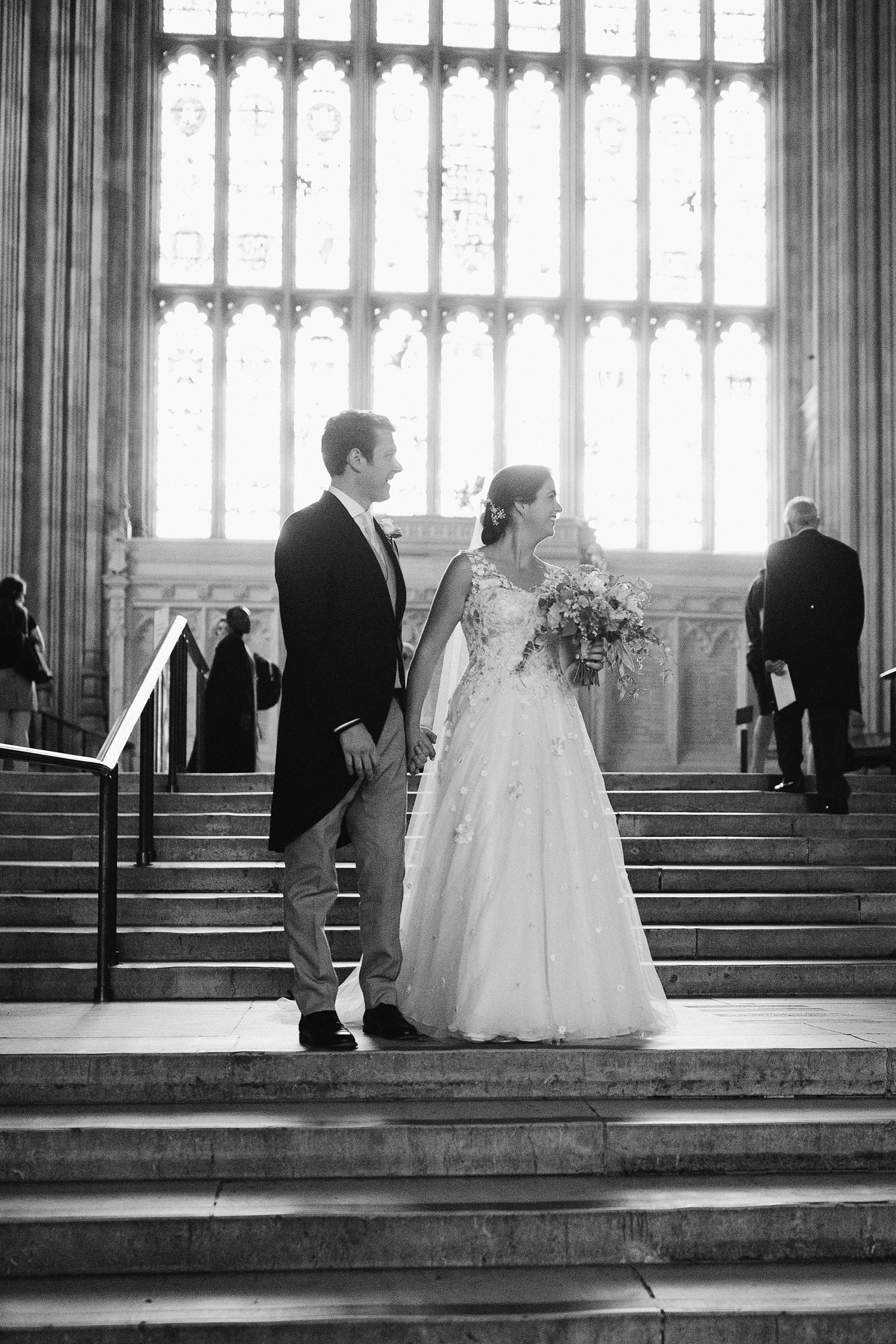 Bride and groom on the steps at a House of Lords Chapel wedding