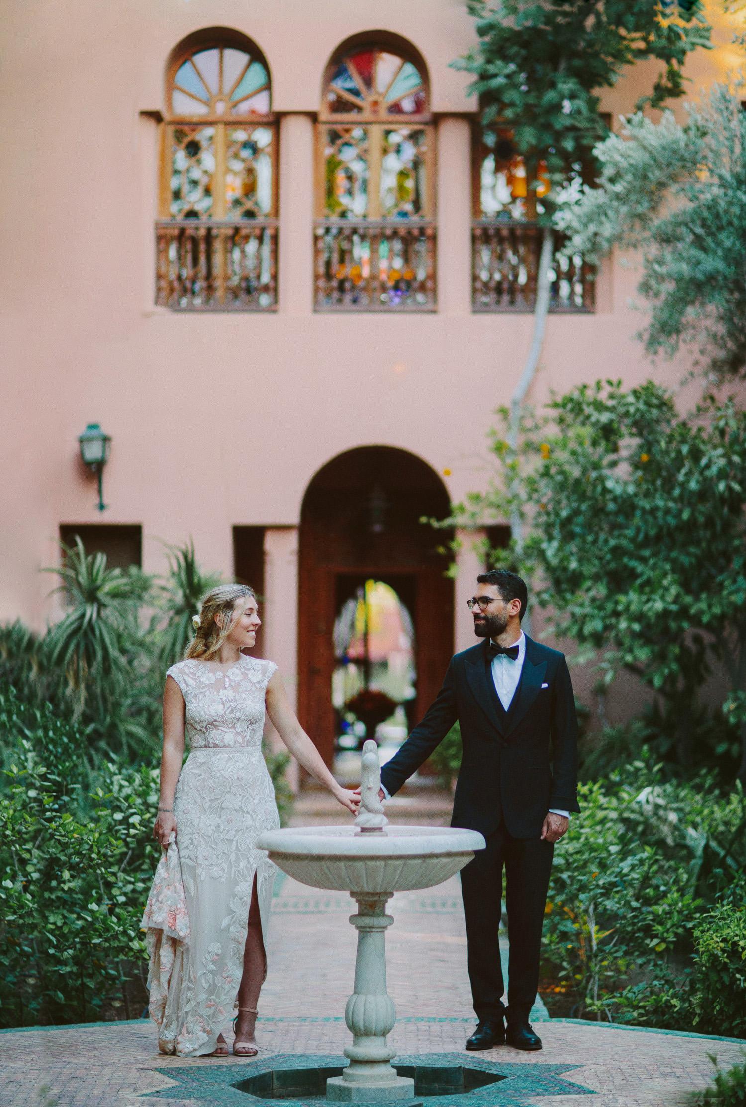 Black tie Marrakech wedding couple holding hands