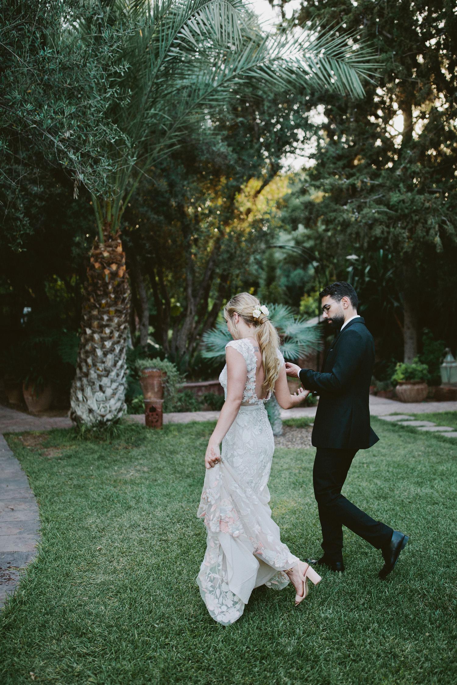 Couple hold hands Marrakech wedding photographer
