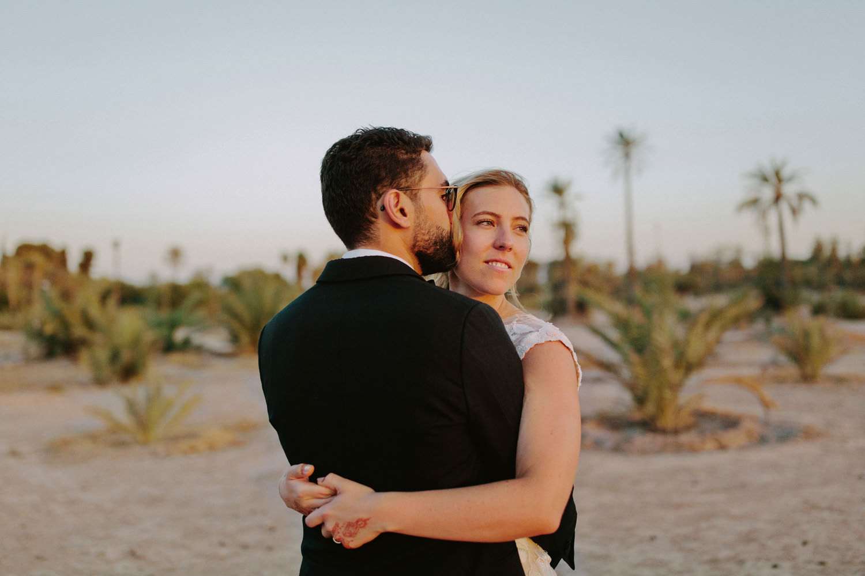 bride and groom hug in the Marrakech desert