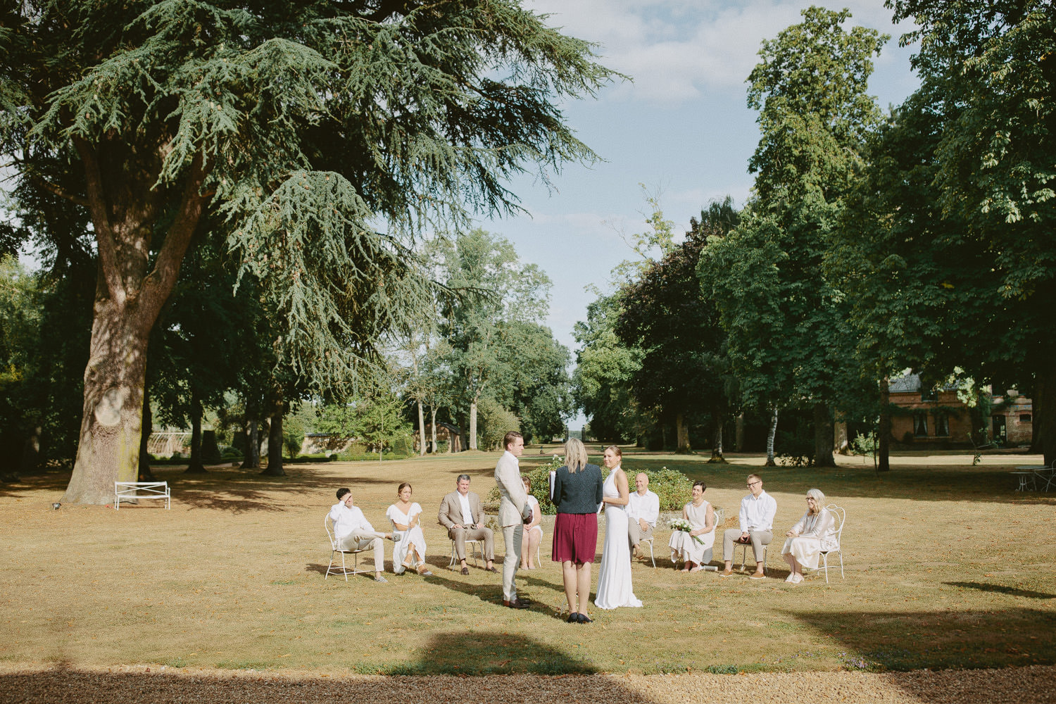 wedding ceremony on lawns of Chateau de Bouthonvilliers