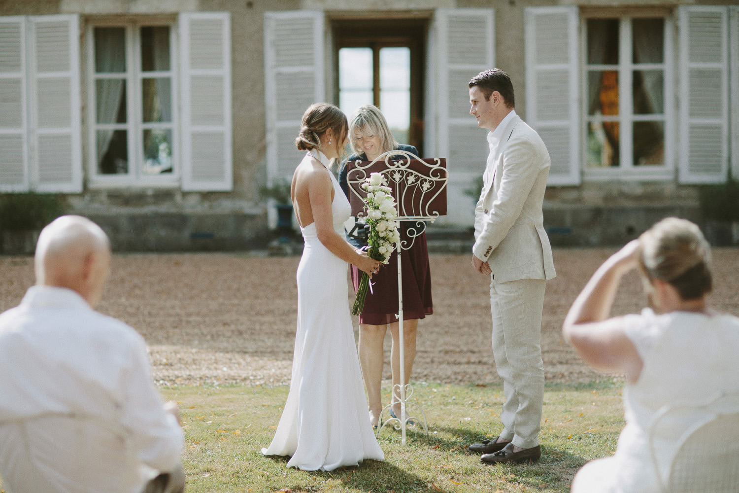 outdoor wedding ceremony at French chateau near Paris