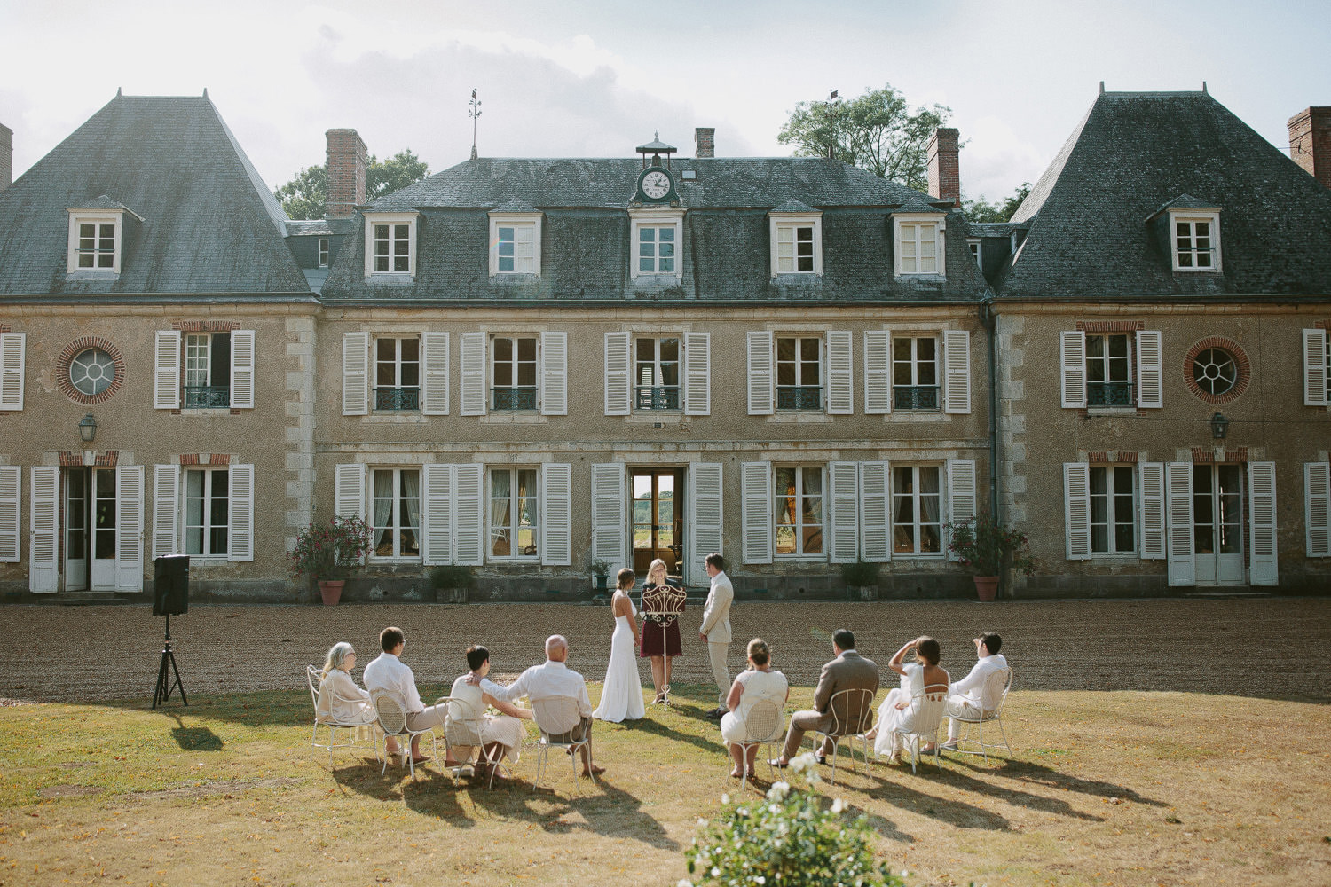 outdoor wedding ceremony in front of Chateau de Bouthonvilliers