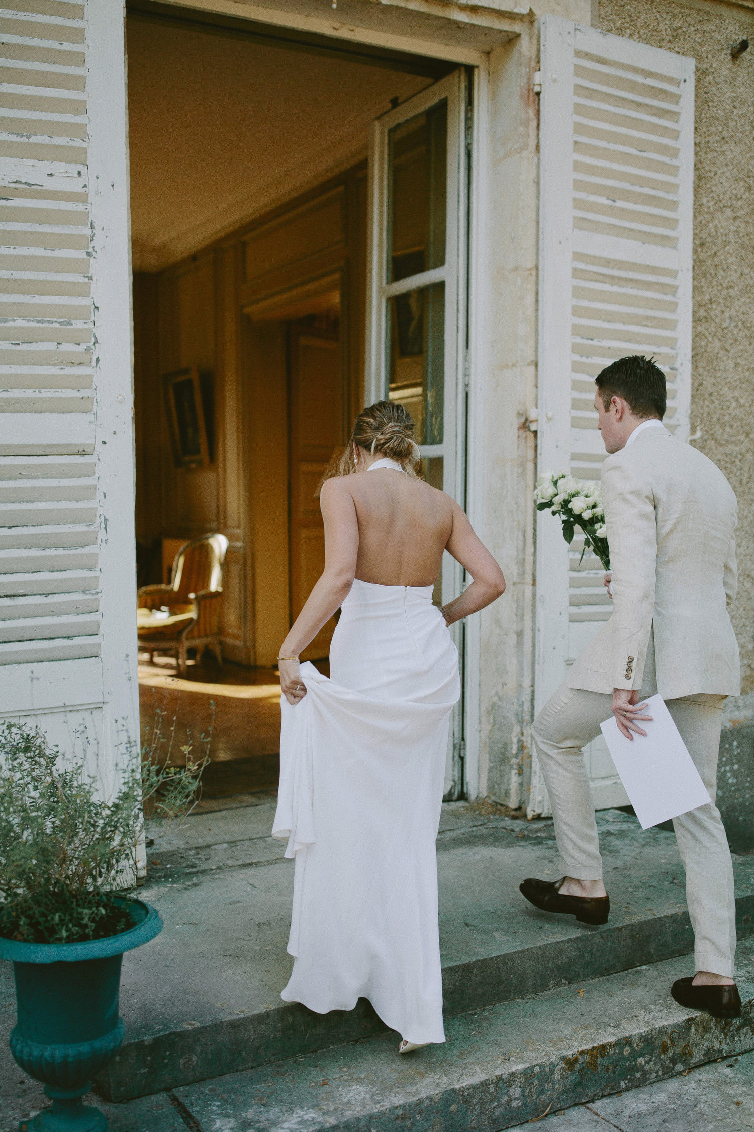 bride and grooming walking into chateau de Bouthonvilliers