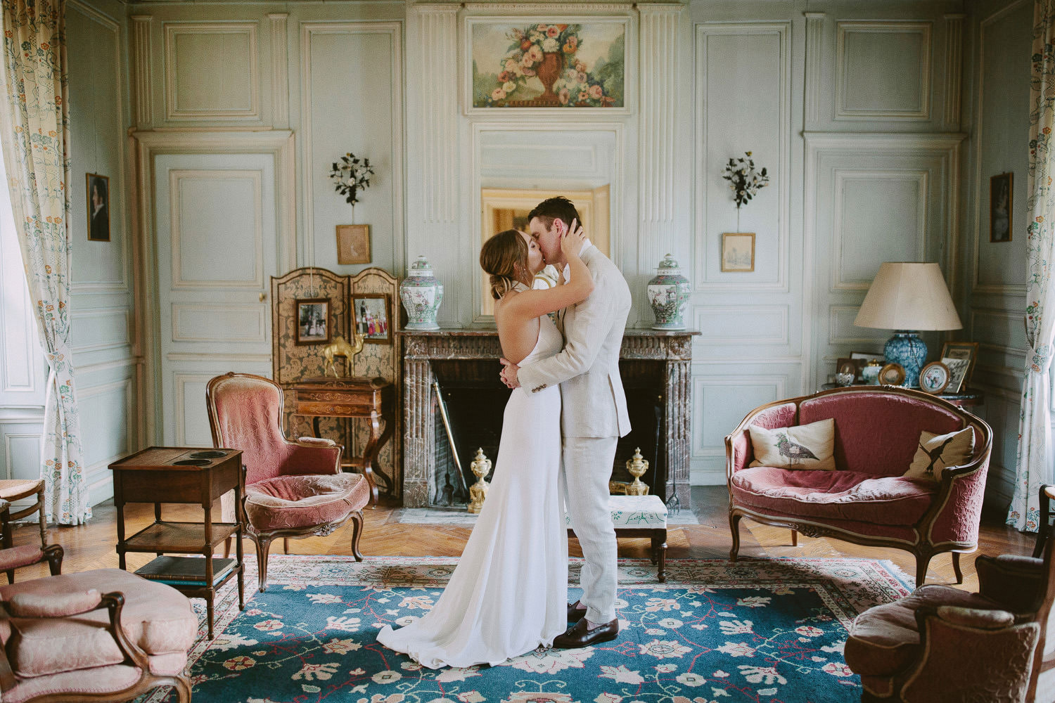 bride and groom kissing inside French chateau
