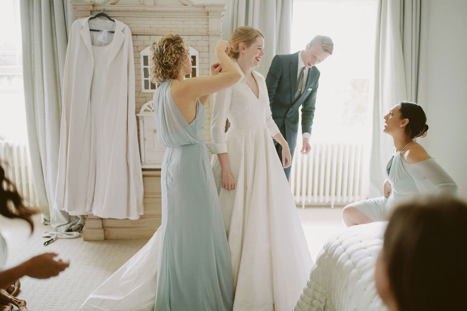 Bride gets ready with her bridesmaids during Suffolk wedding