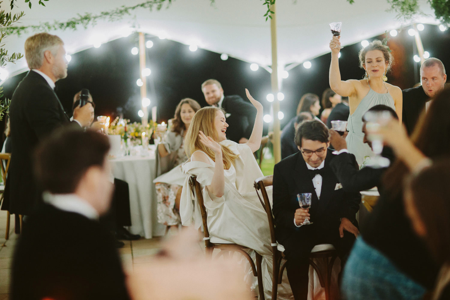 Bride laughing at fathers wedding speech at Suffolk wedding