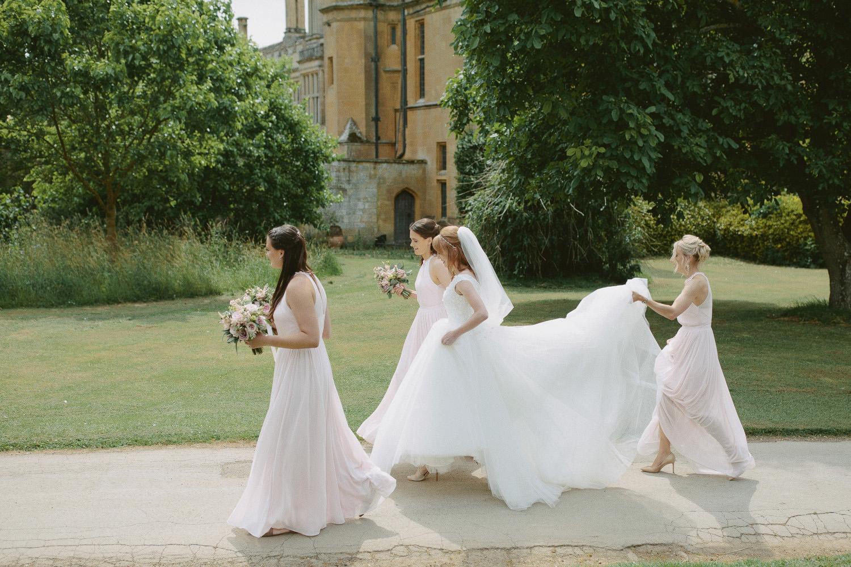 bride walking with bridesmaids at a Sudeley Castle wedding