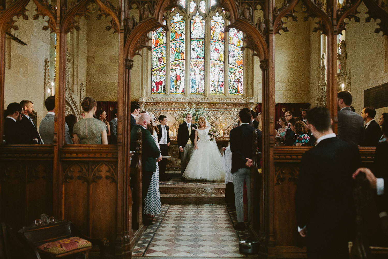 bride and groom in the church at Sudeley Castle