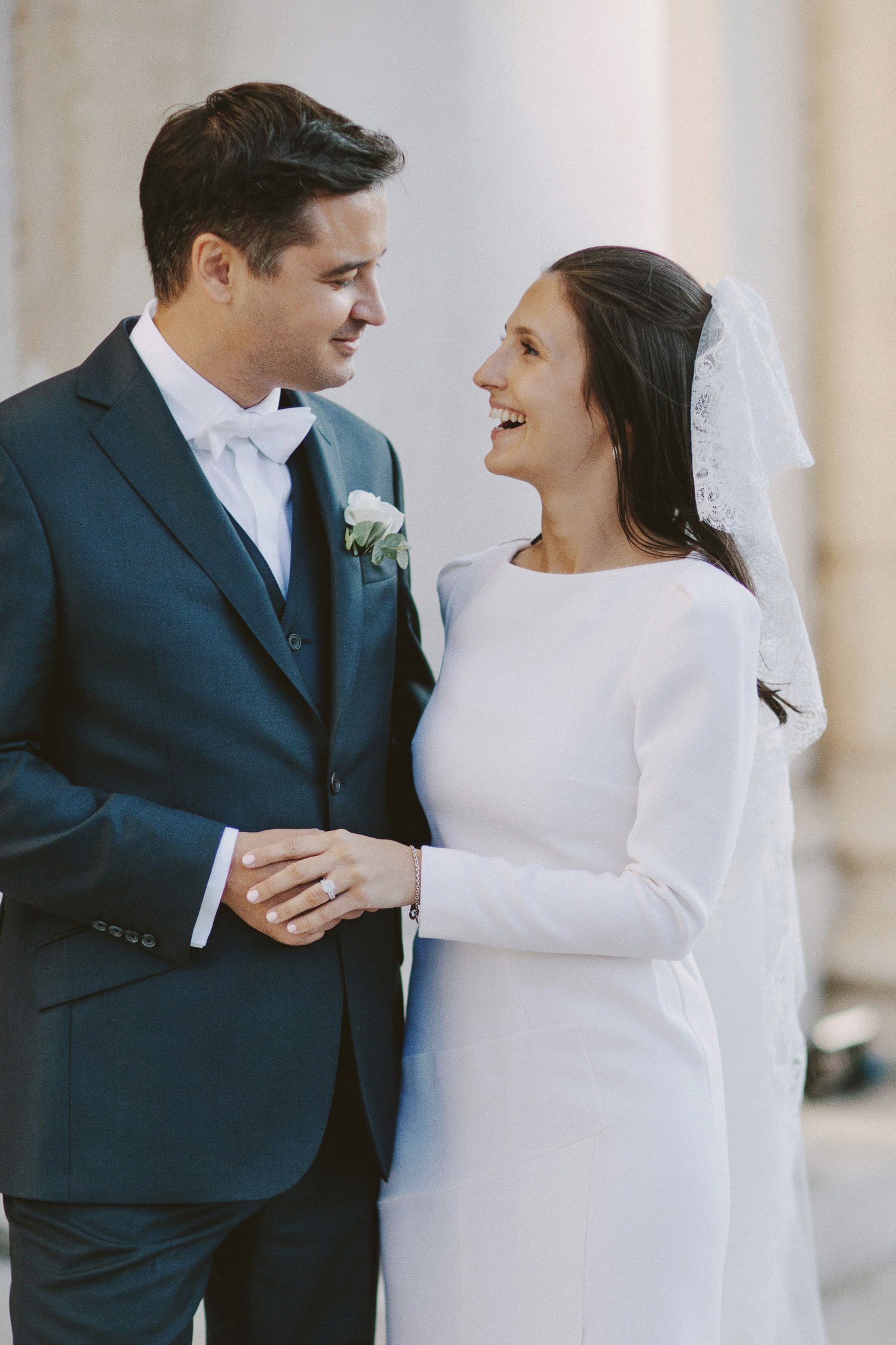 couple portrait with bride and groom smiling at each other