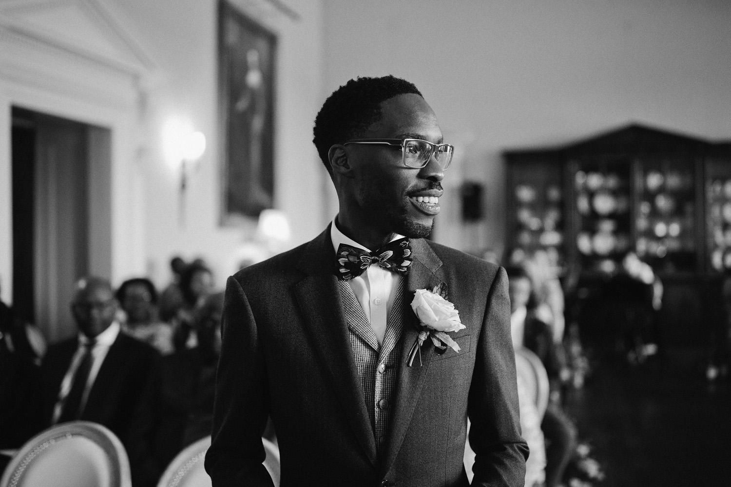 groom in textured bow tie waiting bride before the ceremony at Kirtlington Park