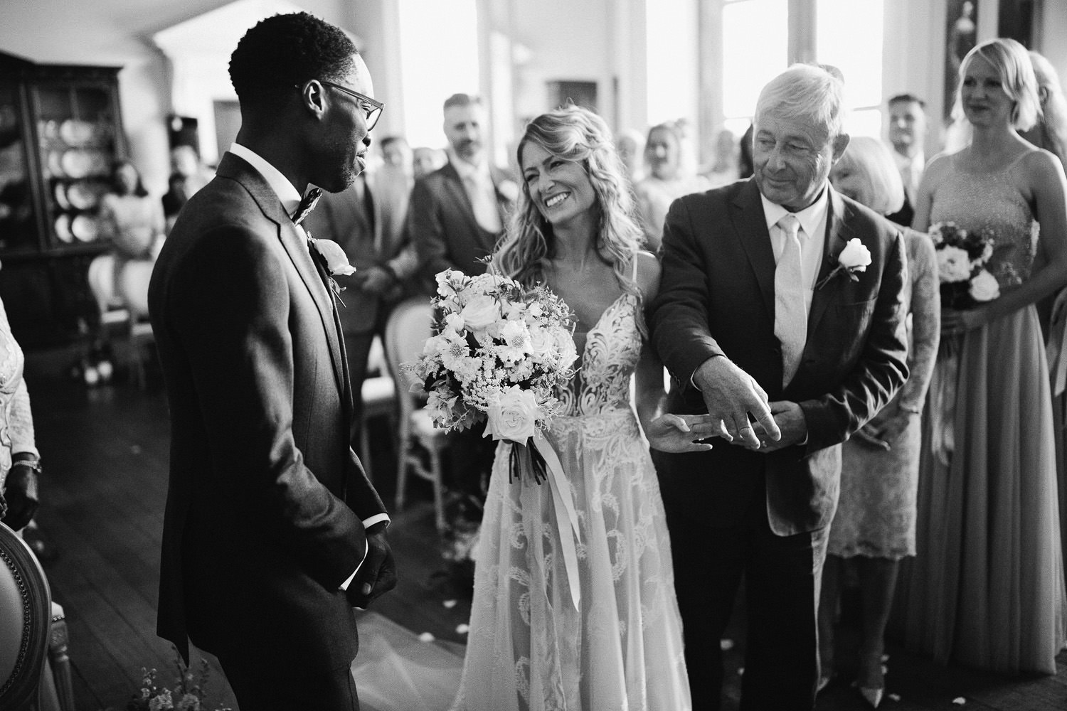 bride walked down aisle with father smiling at groom