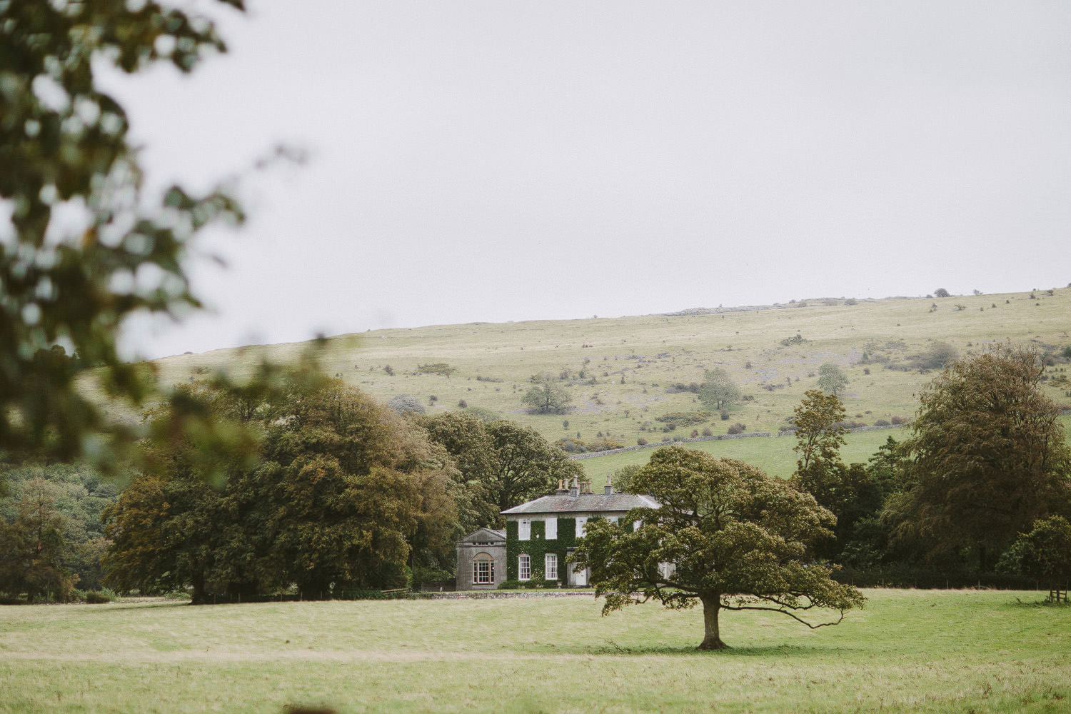 Longlands at Carmel manor house surrounded by hills