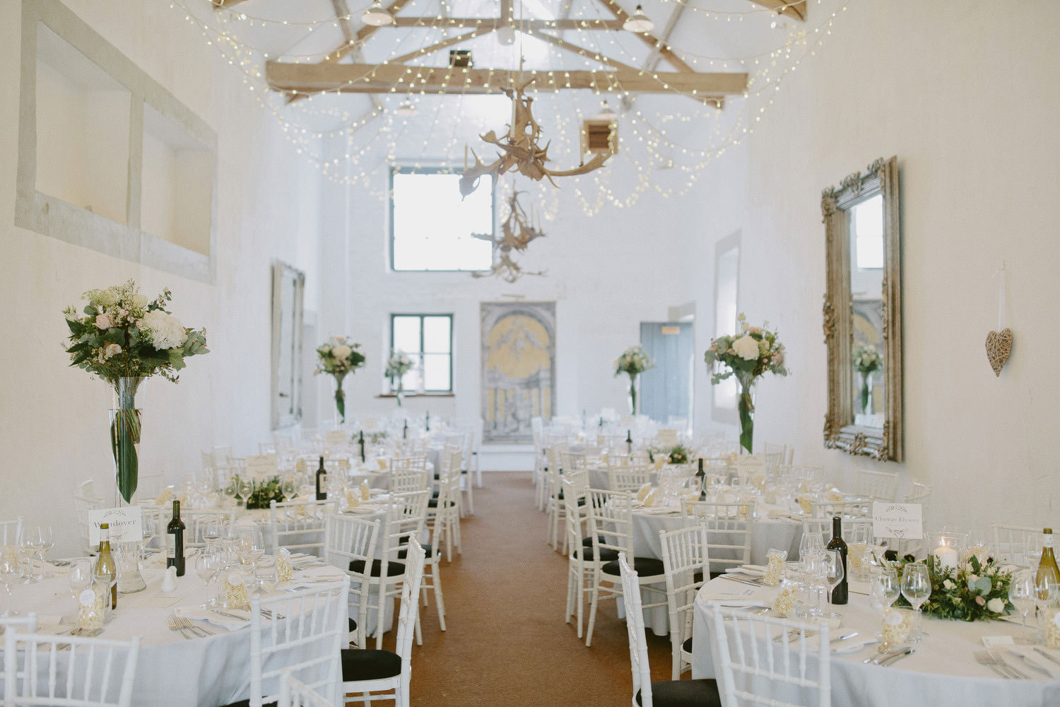 white barn at merriscourt with tables arranged