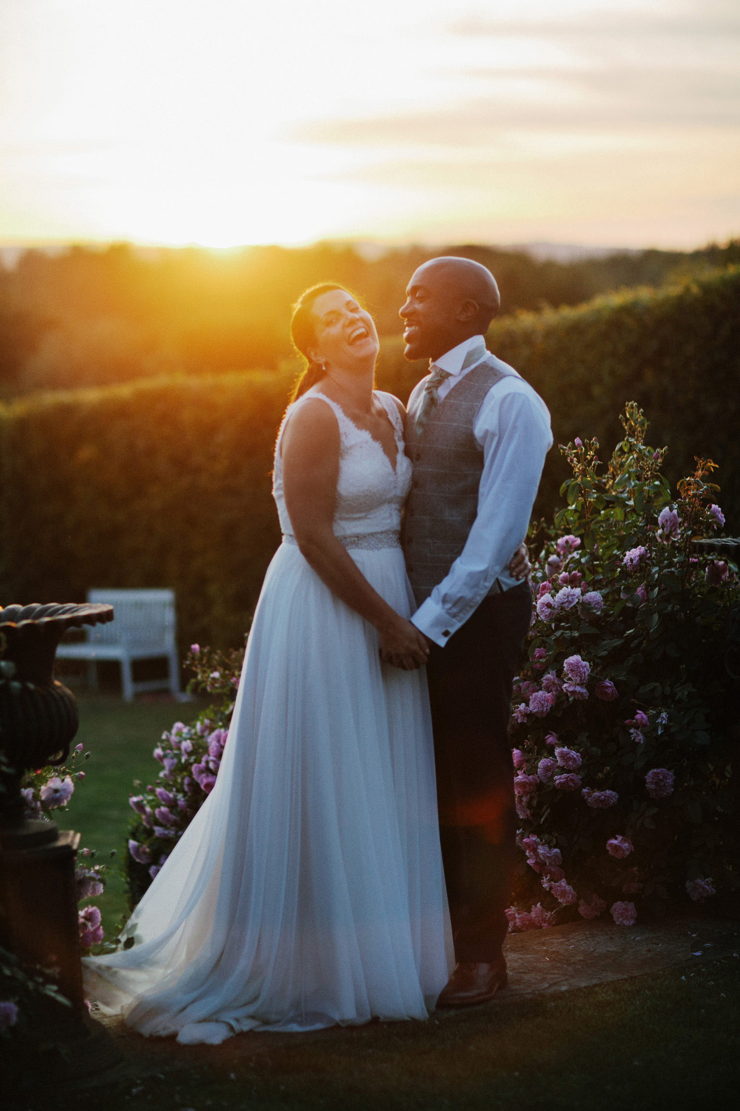 bridal couple laughing in the sunset at merriscourt barn