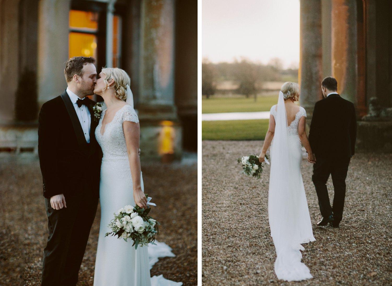 groom in black tie kisses bride